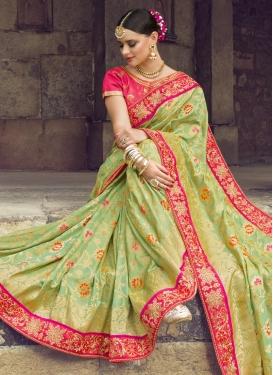 Banarasi Silk Mint Green and Rose Pink Trendy Classic Saree