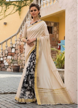 Absorbing Cream Print Traditional Saree