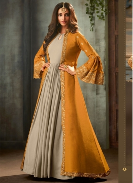 Art Silk Beige and Orange Jacket Style Floor Length Suit