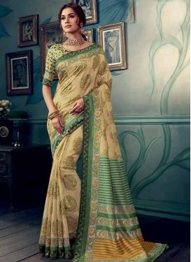 Art Silk Cream and Sea Green Trendy Saree