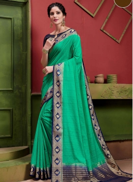 Art Silk Navy Blue and Sea Green Trendy Classic Saree