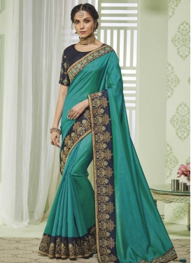 Art Silk Navy Blue and Teal Contemporary Style Saree