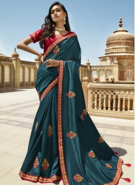 Art Silk Red and Teal Traditional Saree