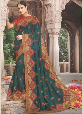 Astounding Embroidered Teal Silk Traditional Saree