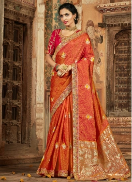 Banarasi Silk Orange And Red Embroidered Work Trendy Classic Saree