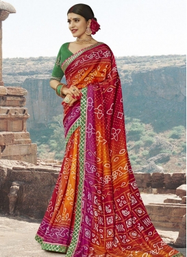 Bandhej Print Work Maroon and Orange Traditional Designer Saree