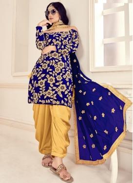 Beige and Blue Velvet Semi Patiala Salwar Kameez