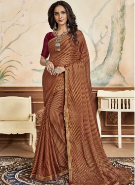 Brown and Maroon Faux Chiffon Traditional Designer Saree