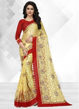 Cream and Red Embroidered Work Brasso Georgette Classic Saree