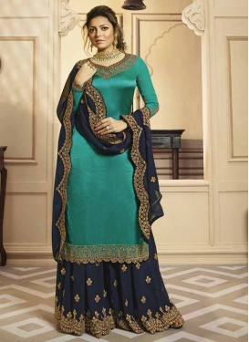 Drashti Dhami Navy Blue and Turquoise Faux Georgette Palazzo Style Pakistani Salwar Suit