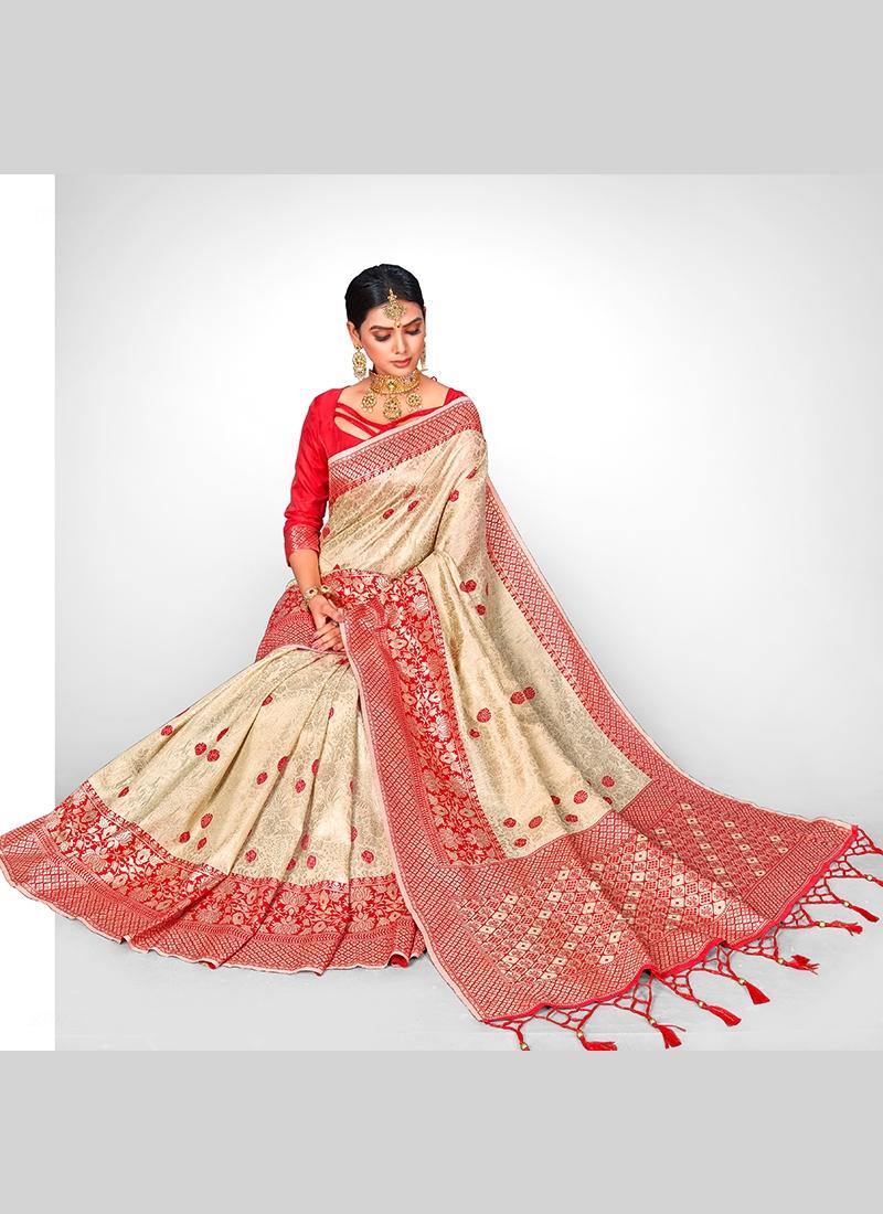 Fascinating Cream Designer Traditional Saree