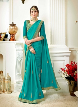 Faux Georgette Turquoise Embroidered Saree