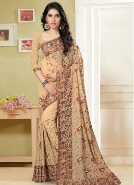 Immaculate Stone Work Cream Color Wedding Saree