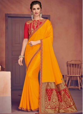 Invaluable Mustard Poly Silk Traditional Saree