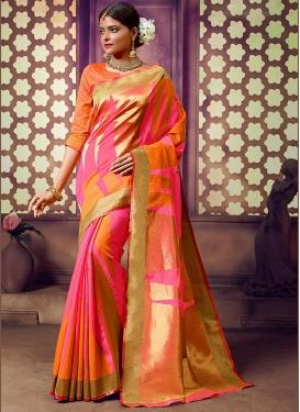 Magnificent Weaving Orange and Pink Silk Saree