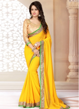 Phenomenal Gold Color Lace Work Casual Saree