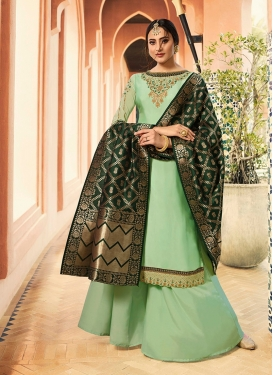 Prominent Embroidered Mint Green Georgette Satin Palazzo Suit