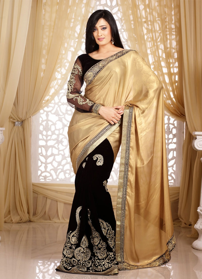 Ruritanian Black And Beige Color Shweta Tiwari Half N Half Saree Hindi tv serial actress shweta tiwari stills in blue transparent saree at the launch of life ok channel's ek thi naayika serial. beige color shweta tiwari half n half saree