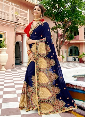 Sorcerous Embroidered Georgette Navy Blue Classic Saree