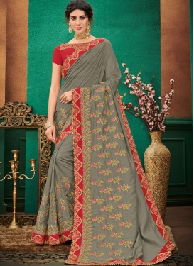Spectacular Embroidered Grey Traditional Saree