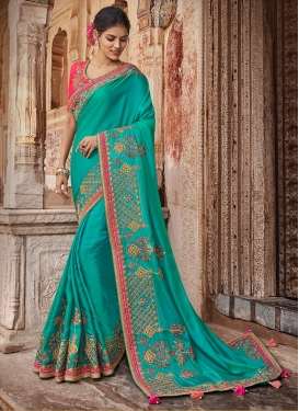 Versatile Satin Silk Turquoise Embroidered Traditional Saree
