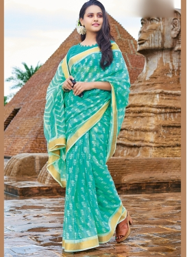 Vibrant Turquoise Cotton Printed Saree
